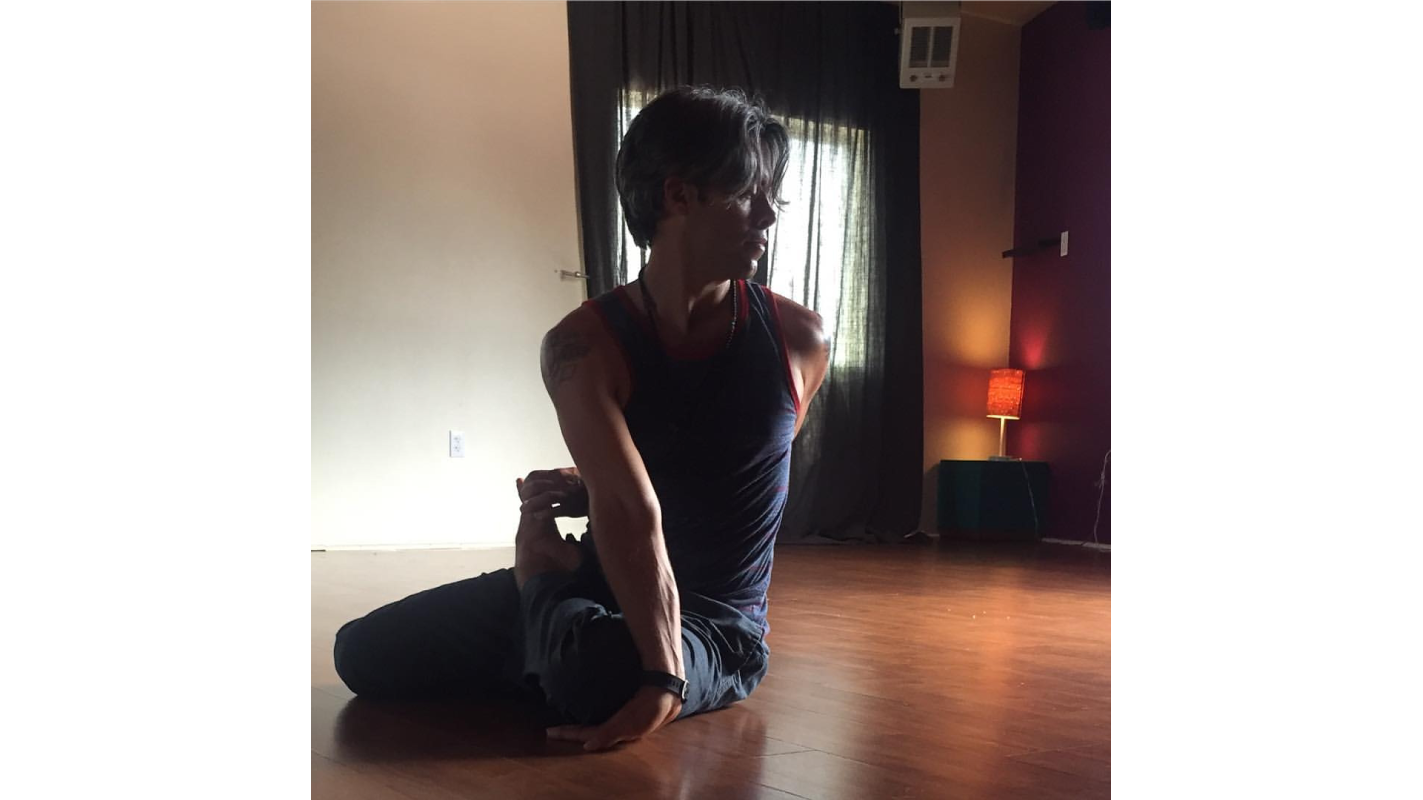 Photo of Austin in yoga pose