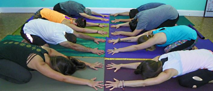 yoga class childs pose